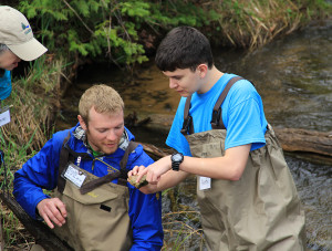 Hands on discovery (photo courtesy of Tip of the Mitt Watershed Council).